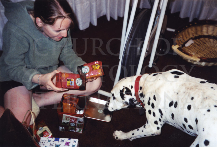 Claire opening Christmas presents at her house, off the Golden Era campus where she lived with her husband Marc